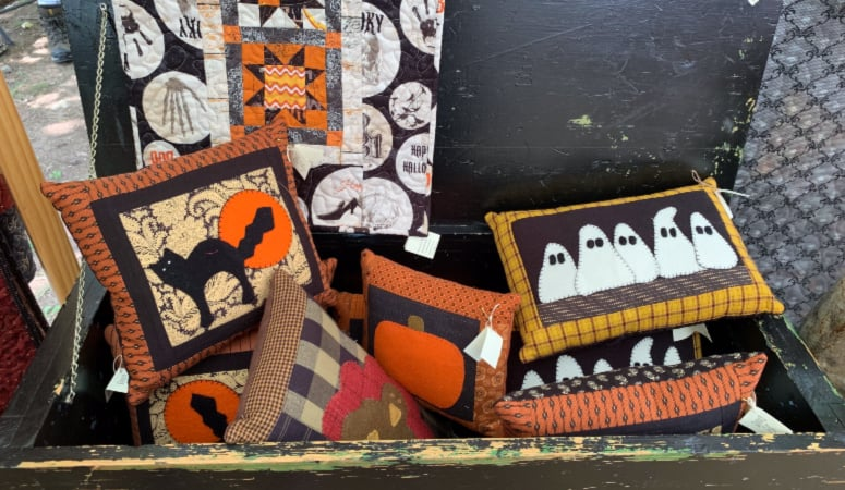 Halloween pillows and quilts from a booth at Shaker Village