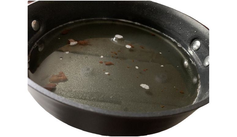 Used Cooking Oil in a Frying Pan